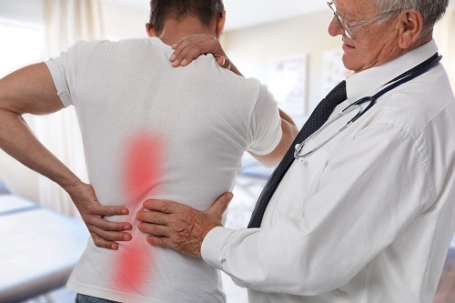 Doctor Treating Man with Back Pain