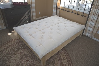 Wool mattress on wood bed frame