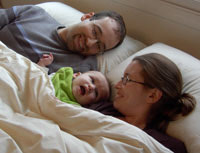 Mom with Dad and baby in safe chemical free wool sleep sytem